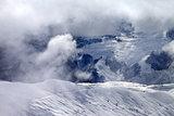 Off-piste slope in sunlight clouds