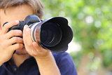 Close up of a photographer using a dslr camera