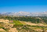 Rural hills ending at dry mountain range
