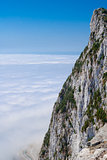Gibraltar cliff face above clouds on sky