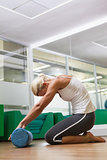 Side view of woman doing fitness exercise in gym