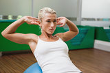 Beautiful woman doing abdominal crunches on fitness ball