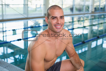 Fit swimmer by the pool at leisure center