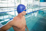 Swimmer looking away in pool at leisure center