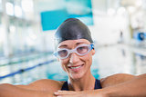Female swimmer in pool at leisure center