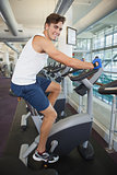 Fit man working out on the exercise bike