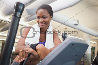 Fit woman working out on the cross trainer