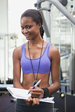 Fit personal trainer smiling at camera