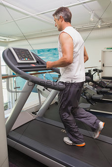 Fit man working out on treadmill