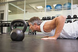Fit man using kettlebells in his workout