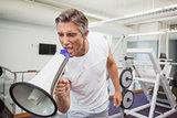 Angry personal trainer shouting through megaphone