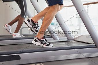 Fit people running on treadmills