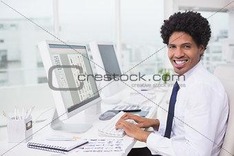 Handsome photo editor working at desk