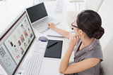 Photo editor working at her desk