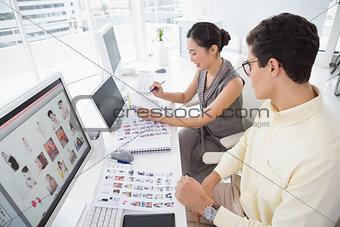 Creative team working at desk