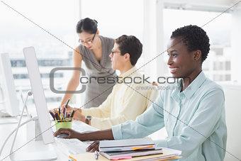 Pretty businesswoman working at her desk
