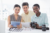 Photo editors working together at desk