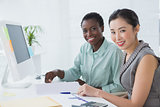 Businesswomen working together at desk