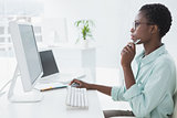 Focused businesswoman working at desk