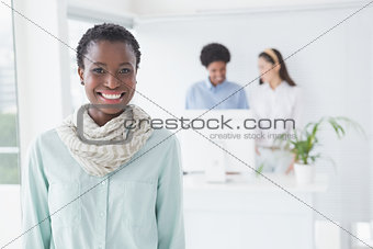 Casual businesswoman smiling at camera
