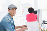 Young creative man working at desk