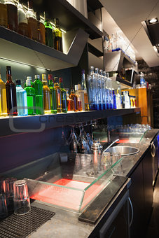 Close up on bar with bottle in a line