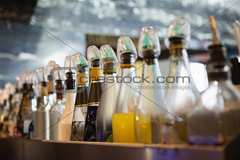 Close up of several bottle in a line