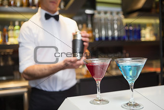 Attractive bar man making a cocktail