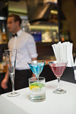 Three color cocktails preparing on the bar counter