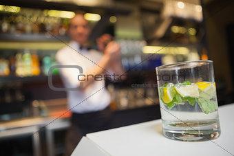 Close up of a mojito at bar counter