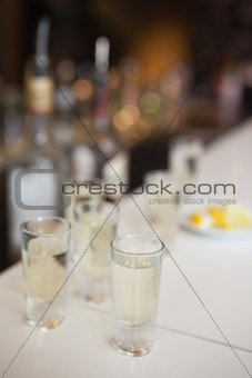 Close up of cocktail into shot glasses