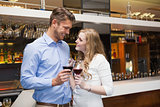 Lovely couple enjoying red wine