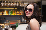 Pretty woman wearing sunglasses with tongue out
