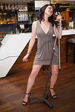 Full length of a woman singing into a microphone