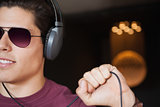 Man in sunglasses listening to music with headphone