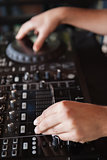 Close up of hands spinning the decks
