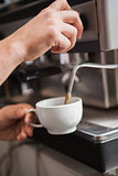 Close up of barista making cup of coffee