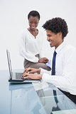 Smiling designer team using laptop