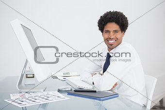 Smiling businessman sitting and looking at camera