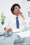 Businessman in shirt writing and thinking