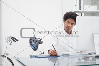 Focused designer drawing on digitizer