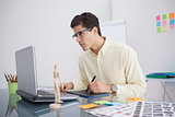 Focused designer using digitizer at his desk