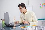 Focused designer using digitizer at his desk