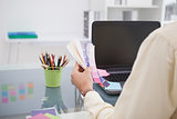 Designer working at his desk with colour sample