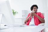 Relaxed businessman holding glass of milkshake