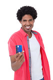 Happy man showing credit card