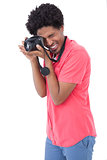 Happy man taking photograph with digital camera