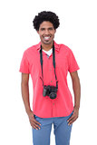 Handsome man with camera around his neck