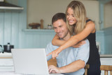 Cute couple using laptop together