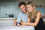 Cute couple using smartphone together